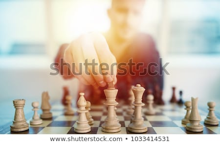 Business tactic with chess game and businessmen that work together in office. Concept of teamwork, p Stock photo © alphaspirit