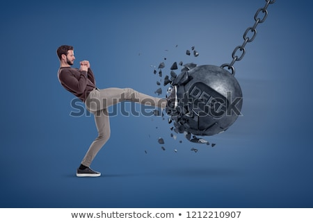 Businessman gets a hit from a giant hand Stock photo © ra2studio