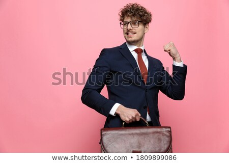 businessman celebrating with fist in the air looks to side Stock photo © feedough