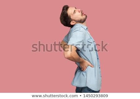 Homem dor de volta moço sofá Foto stock © AndreyPopov