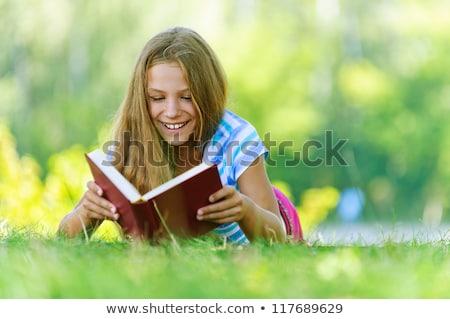 Derűs gyermek olvas érdekes könyv nyár Stock fotó © konradbak