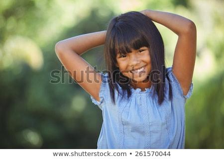 Zwart haar meisje portret gezicht kind schoonheid Stockfoto © boggy
