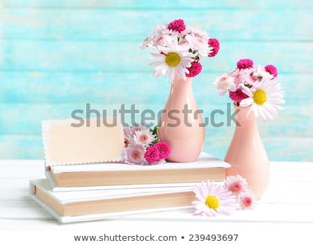 Vase with beautiful chrysanthemum flowers on light table Stock photo © Melnyk