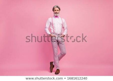 Jólöltözött tart kéz zseb néz előre Stock fotó © feedough