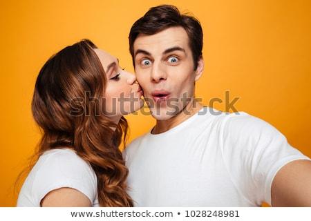 Ritratto bella donna bacio giovane guancia riposo Foto d'archivio © deandrobot