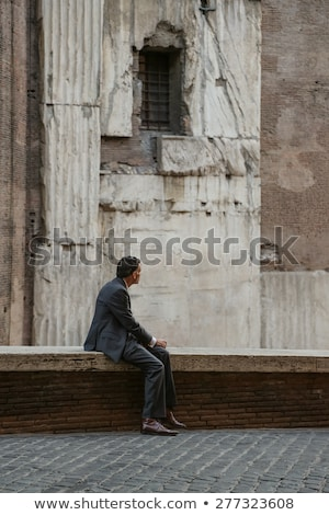 Business person looking to ruined city from distance Stock photo © ra2studio