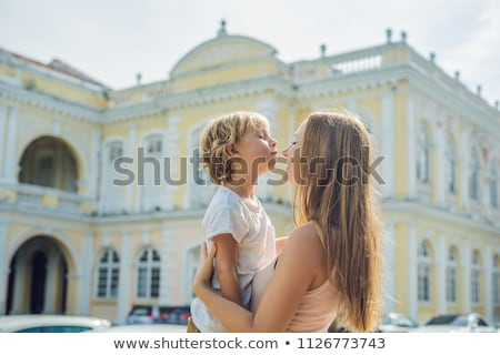 Mom and son on background of Old Town Hall in George Town in Penang, Malaysia. The foundation stone  Stock photo © galitskaya