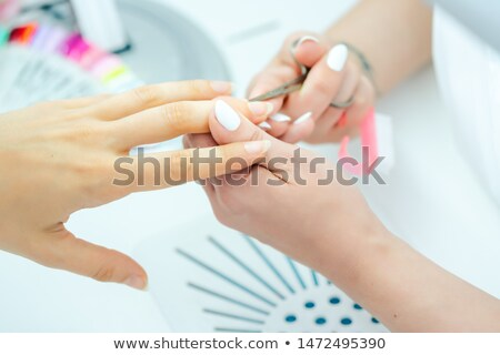 Woman having her finger nails cut during manicure Stock photo © Kzenon