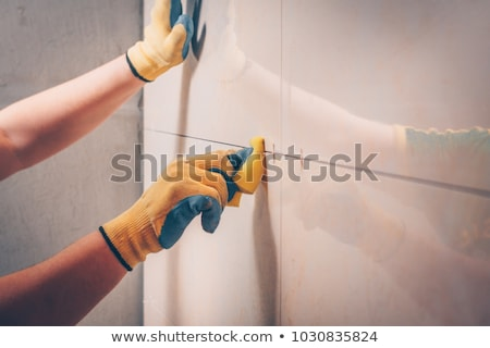 professional worker laying tile, repair work Stock photo © rogistok