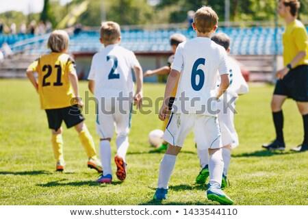 A mixed-gender soccer team playing a football match Stock photo © matimix