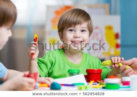Criatividade criança pequeno menino tabela mulher Foto stock © galitskaya