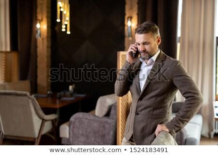Elegáns üzletember kabát fehér póló áll Stock fotó © pressmaster