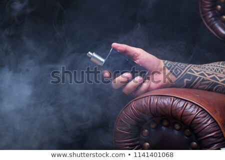 Hand Holding Vape Electronic Cigarette Tattoo Stock photo © patrimonio