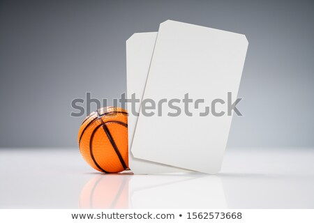 Miniature Basketball With White Blank Tickets On Reflective Desk Stock photo © AndreyPopov