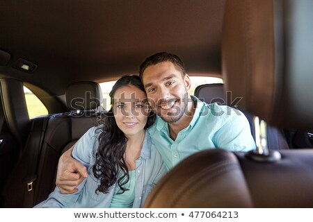 happy man and woman hugging on taxi back seat Stock photo © dolgachov