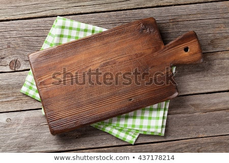Kitchen table with utensils, cutting board and tablecloth Stock photo © karandaev