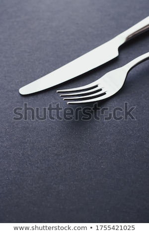 Fork and knife, silver cutlery for table decor, minimalistic design and diet Stock photo © Anneleven