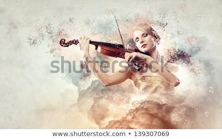 Szenvedélyes nő hegedűművész játszik klasszikus zene kézzel készített Stock fotó © Giulio_Fornasar
