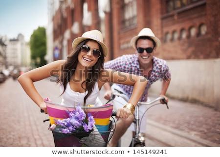 feliz · casal · bicicleta · parque · vermelho · primavera - foto stock © fotografci