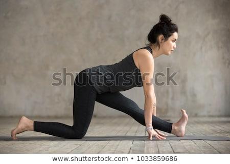 Fit Woman Practicing Monkey God Yoga Pose Stock photo © rognar
