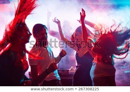 Godere dance giovane ragazza il piacere discoteca ritratto Foto d'archivio © pressmaster