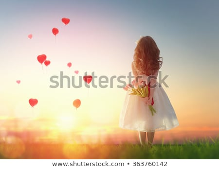 Happy girl flying, holding red heart balloons  stock photo © Anna_Om