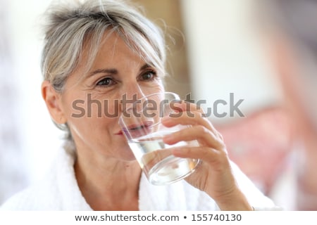 senior woman drinking water Stock photo © photography33