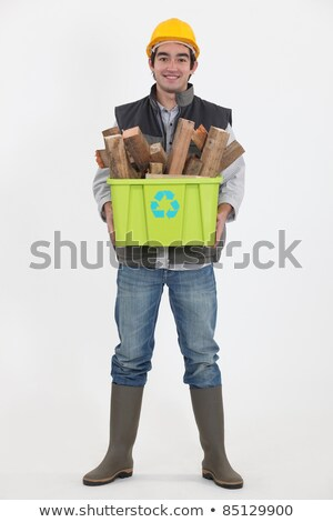Environmentally friendly tradesman taking out the recycling Stock photo © photography33