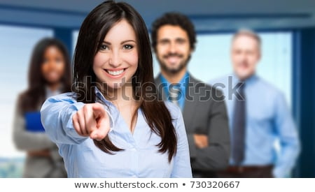 smiling businesswoman pointing stock photo © stryjek
