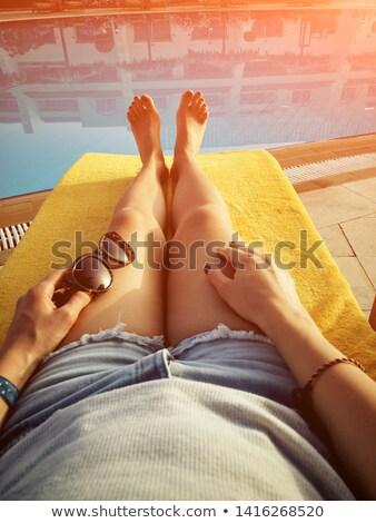 Female legs with flip-flops Stock photo © Nobilior