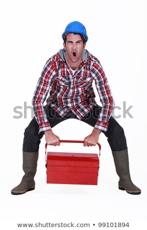 Worker struggling to lift tool box Stock photo © photography33