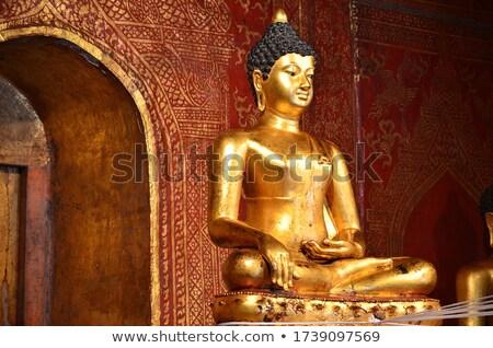 'Phra Sihing Buddha' Thai gold statues at Phra Singh Temple Stock photo © nuttakit