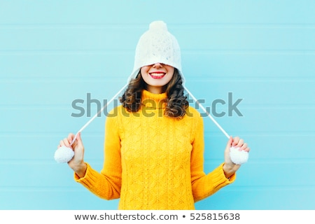 portrait of a happy woman with a winter cap stock photo © rob_stark