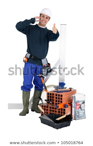 a bricklayer posing with his tools and building materials stock photo © photography33