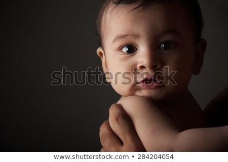 Meglepődött indiai baba fiú sötét szürke Stock fotó © ziprashantzi