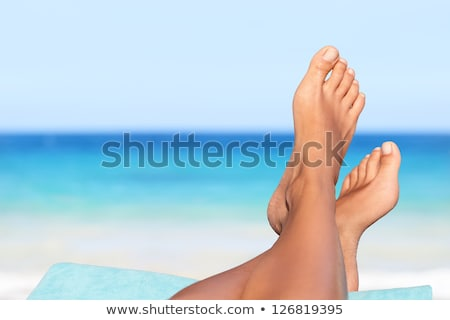 Homme · pieds · plage · soleil · crème - photo stock © tannjuska