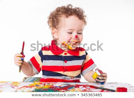 Bonitinho pequeno bebê pintura agitar-se cores Foto stock © juniart
