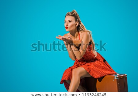 old fashioned pin up girl blowing a kiss retro style stock photo © gromovataya