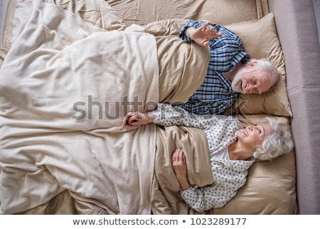 tranquil couple looking at each other on their bed stock photo © wavebreak_media