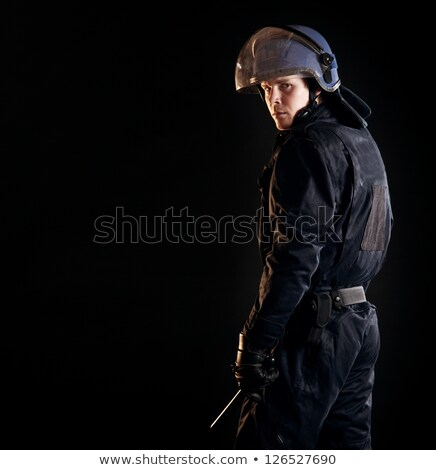 riot policeman with nightstick isolated stock photo © goce