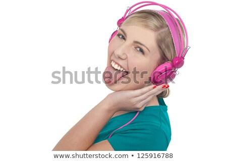 mujer · auriculares · diversión · amoroso - foto stock © stockyimages