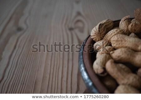 макроса выстрел арахис деревянный стол Сток-фото © deymos