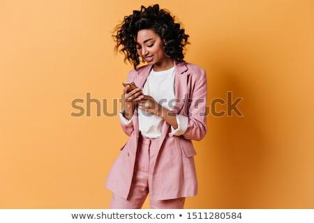 Mooie business meisje roze pak geïsoleerd Stockfoto © Len44ik