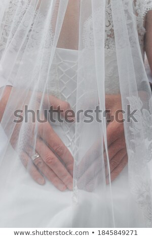Foto stock: Bridegrooms Hand On The Back Of His Bride