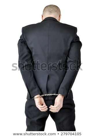 Businessman standing with handcuffs Stock photo © wavebreak_media