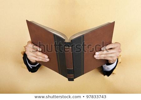 Empresário velho livro mão negócio livro Foto stock © michaklootwijk