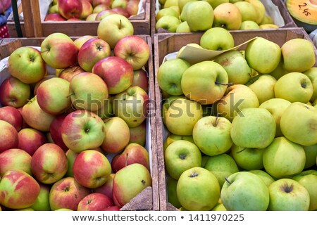 yummy pile of apples for sale in a market stall stock photo © stockyimages