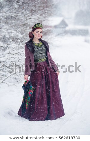 attractive woman wearing a folk russian dress stock photo © stepstock