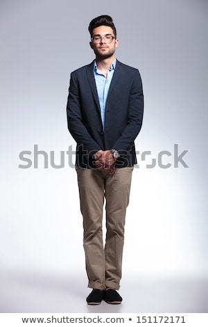 young fashion man with hands at crotch Stock photo © feedough
