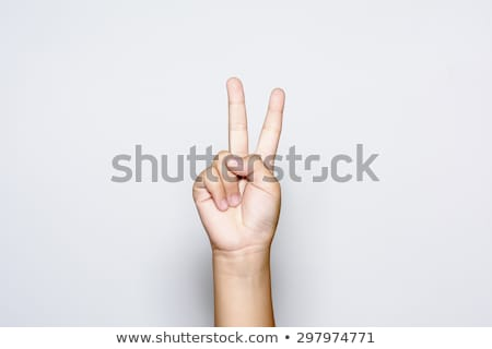 Kéz kettő ujjak felfelé béke győzelem Stock fotó © bloodua